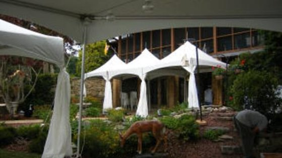 Picture of three 10x10 tent together with leg skirts