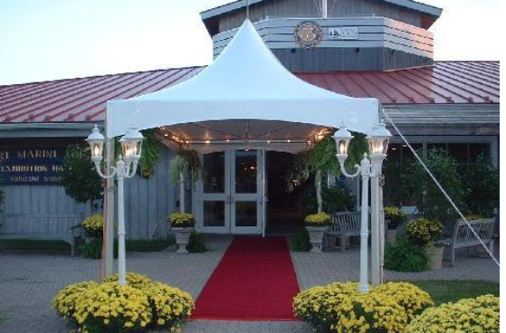 10x20 tent shown as an entrance with red carpet, lamp posts and flowers