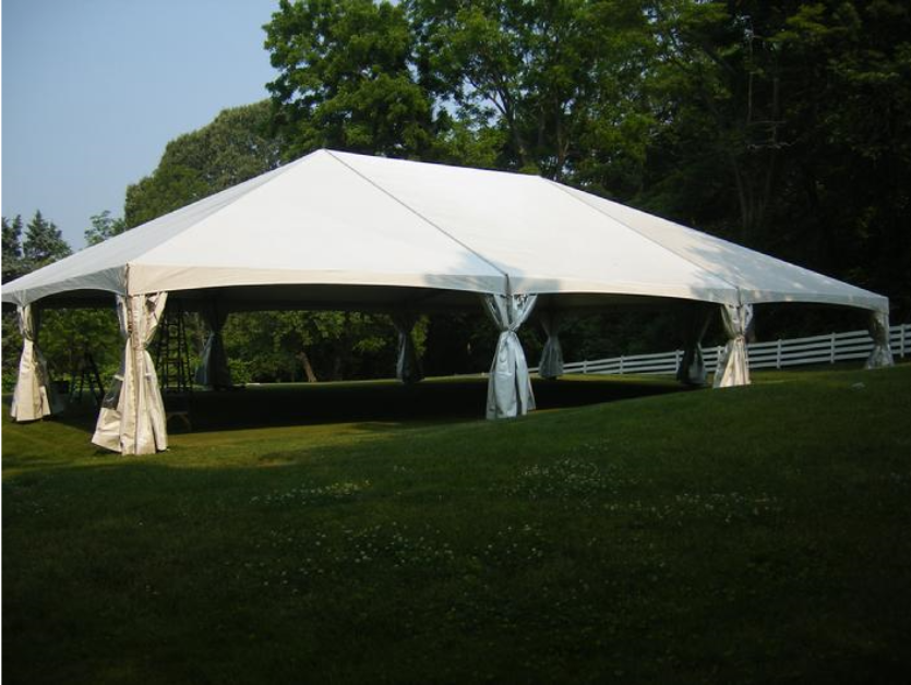 Picture of a 40x60 white frame tent with side walls pulled back and tied around the tent leg