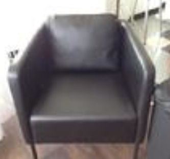Paded black leather chair. The black leather arms are solid black leather