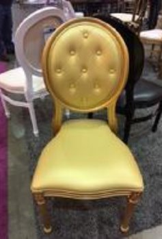 a gold chair which is a little large then a normal chair.  It has a tuft back a padded seat