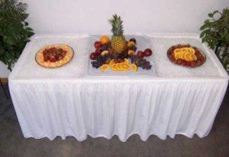 6 ft Ice table filled with ice and fruit trays placed on top of ice to make a pretty display and keep the items cold