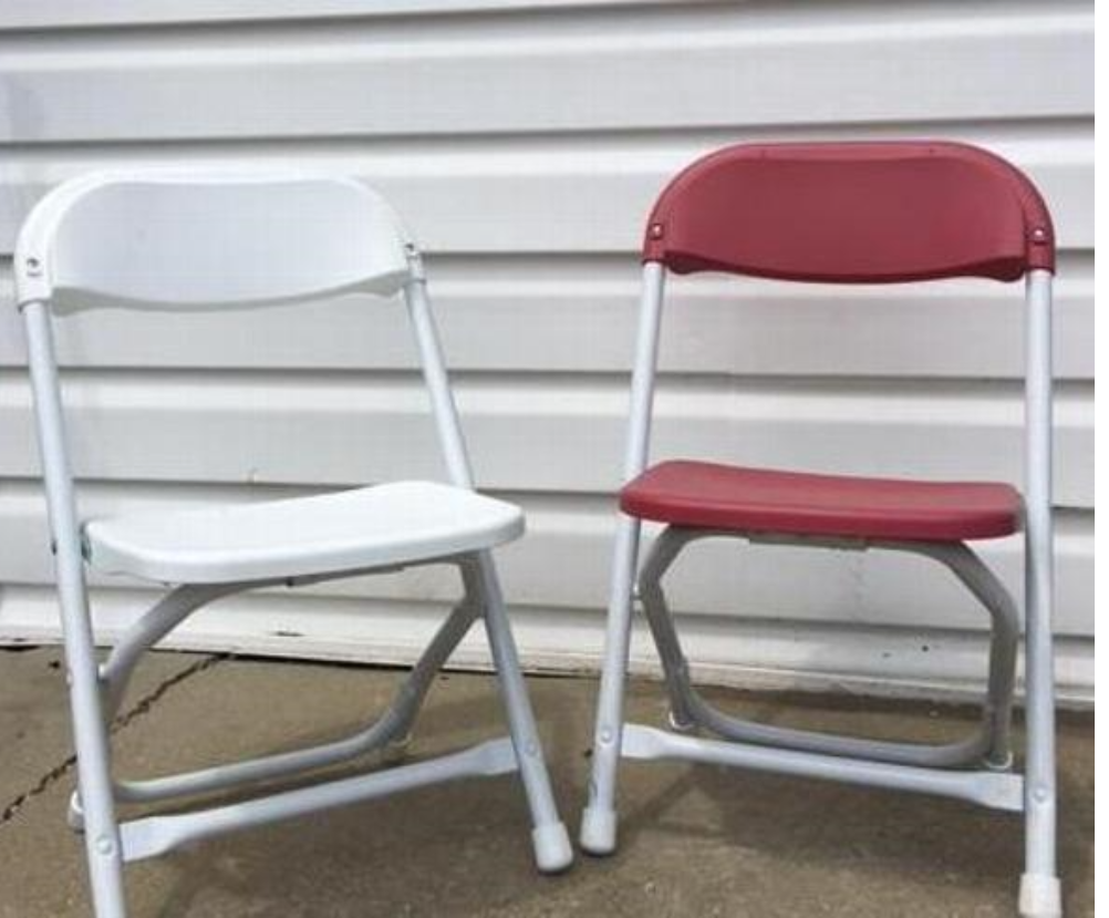 White or Reddish Kiddie chair.  It sits low to the ground for a childs seat.  The frame is white metal and the seat and back are plastic in white or reddish
