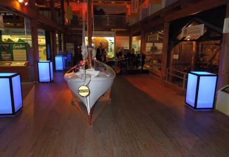 Showing four light up cocktial tables in blue inside Calvert Marine Museum