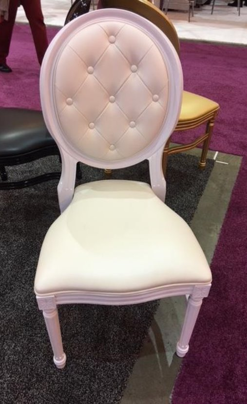 A White king louie chair which has a tuft back and a padded seat